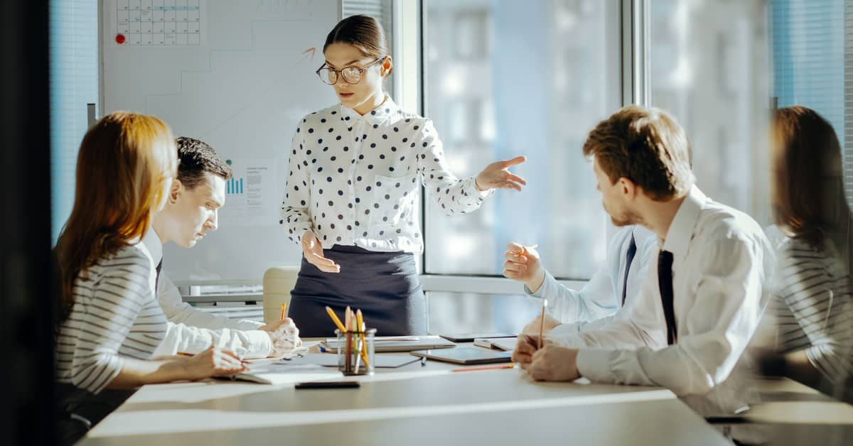 Human-Resources-Navigating-Conflict-Workplace-Conflict-With-Employees-At-Conference-Table