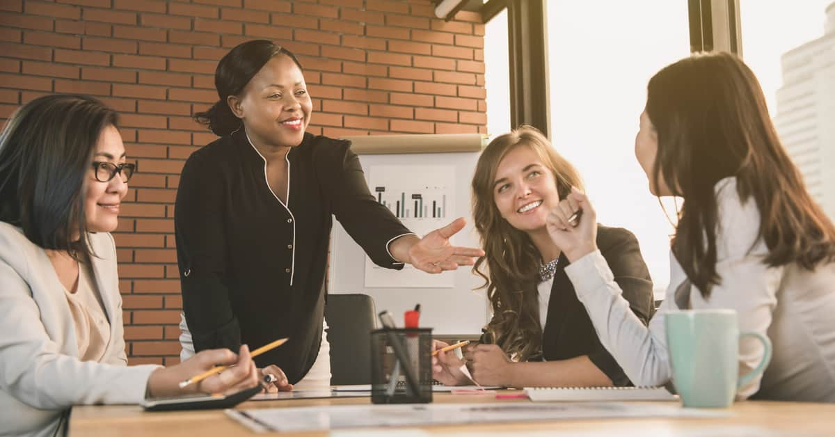 an-executive-leading-with-empathy-at-a-meeting-with-female-employees