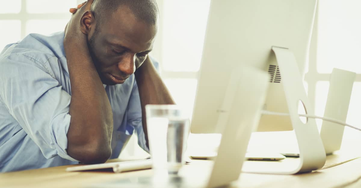 depressed-employee-at-desk-considers-reaching-out-to-hr-for-help-and-support