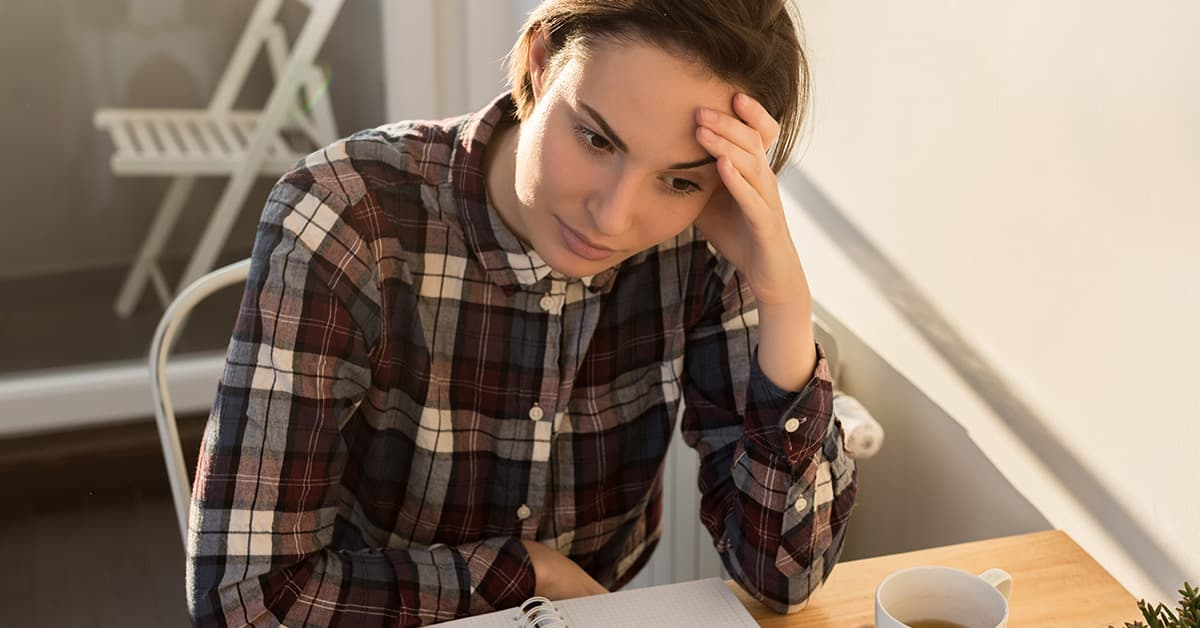 woman-stressed-because-she-isnt-performing-at-her-job